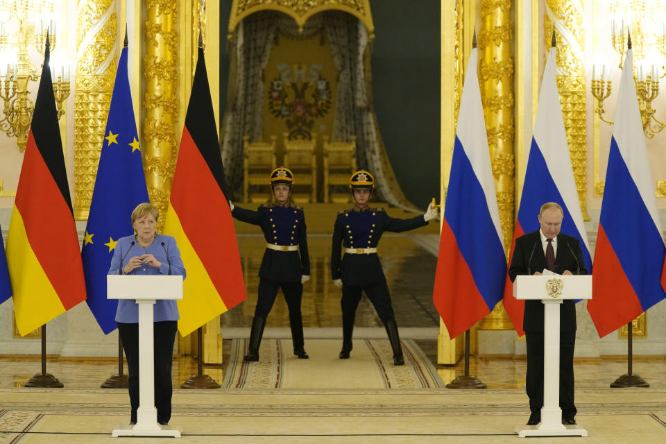 Russian President Vladimir Putin, right, and German Chancellor Angela Merkel attend a joint news conference following their talks in the Kremlin in Moscow, Russia, Friday, Aug. 20, 2021. The talks between Merkel and Putin are expected to focus on Afghanistan, the Ukrainian crisis and the situation in Belarus among other issues. (AP Photo/Alexander Zemlianichenko, Pool)