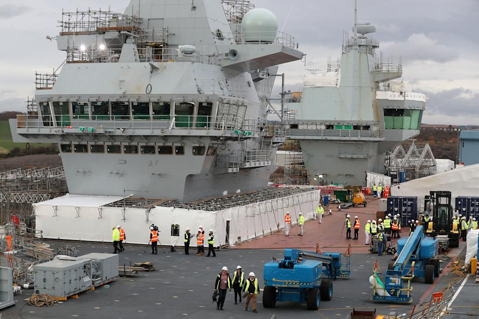 Work continues on the flight deck during a tour of the under-construction aircraft carrier, HMS Prince of Wales, at BAE Systems in Rosyth, Fife. (Photo by Andrew Milligan/PA Images via Getty Images)
