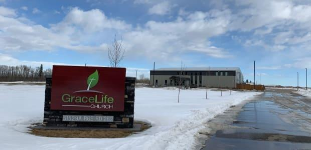In an emailed statement to CBC News, RCMP confirmed they were on scene at the church Wednesday, assisting the AHS as they affect a closure under Section 62.1 of the Alberta Public Health Act. (Andreane Williams/Radio-Canada - image credit)