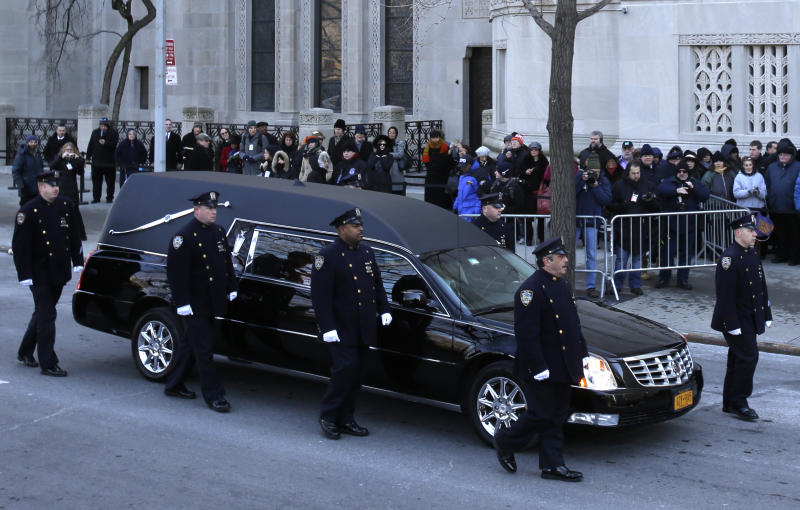 Police escort the hearse containing the body of former New York City Mayor Ed Koch to Emple Emanu-El for his funeral in New York, Monday, Feb. 4, 2013. Koch died Friday of congestive heart failure at age 88. (AP Photo/Seth Wenig)