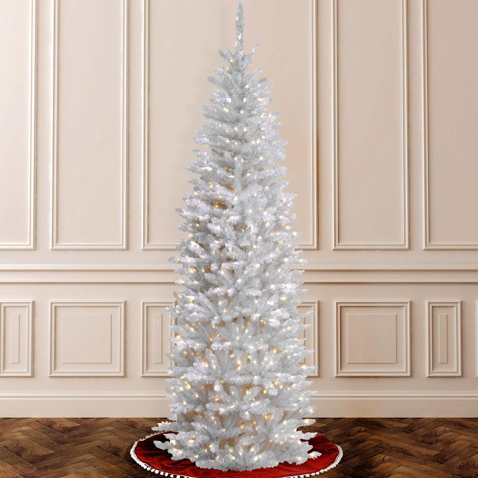 """<p><strong>CC Christmas Decor</strong></p><p>walmart.com</p><p><strong>$116.91</strong></p><p><a href=""""https://go.redirectingat.com?id=74968X1596630&url=https%3A%2F%2Fwww.walmart.com%2Fip%2F56162984%3Fselected%3Dtrue&sref=https%3A%2F%2Fwww.thepioneerwoman.com%2Fholidays-celebrations%2Fg37635843%2Fwhite-christmas-tree-decorations%2F"""" rel=""""nofollow noopener"""" target=""""_blank"""" data-ylk=""""slk:Shop Now"""" class=""""link rapid-noclick-resp"""">Shop Now</a></p><p>With its tall, slim profile, this 6.5-foot pencil tree is perfect for apartment living. It comes with a white tree stand and pre-strung white lights. </p>"""