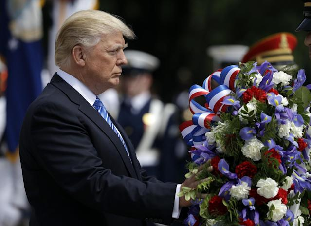 <p>President Trump lays a wreath at the Tomb of the Unknowns at Arlington National Cemetery, May 29, 2017, in Arlington, Va. (Photo: Evan Vucci/AP) </p>
