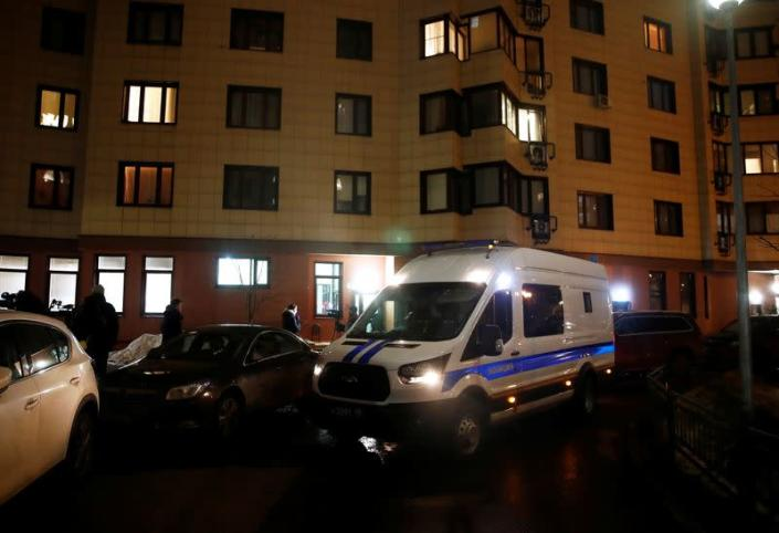 A police van is parked next to a building, where the apartment of Russian opposition leader Alexei Navalny is located, in Moscow