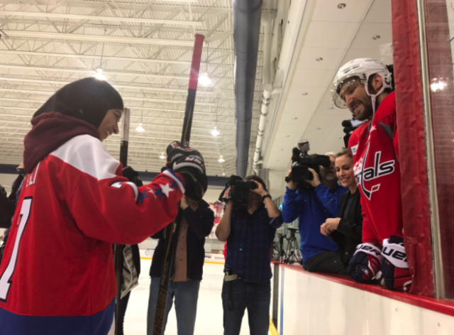 "Photo of Fatima Al Ali and Alex Ovecgkin tweeted by <a class=""link rapid-noclick-resp"" href=""/nhl/teams/was/"" data-ylk=""slk:Washington Capitals"">Washington Capitals</a>."