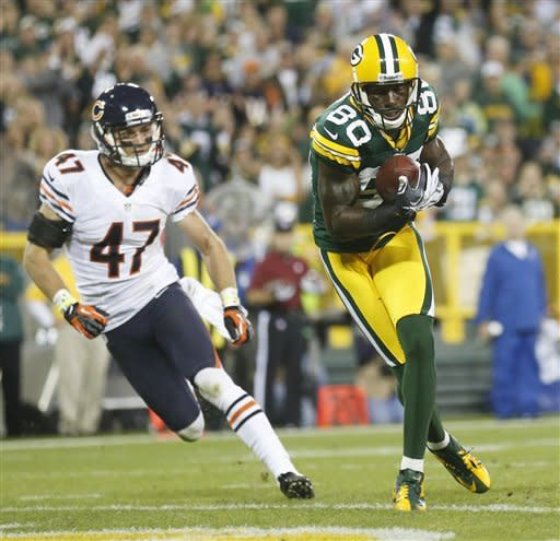 Green Bay Packers' Donald Driver catches a touchdown pass in front of Chicago Bears' Chris Conte (47) during the second half of an NFL football game Thursday, Sept. 13, 2012, in Green Bay, Wis. (AP Photo/Jeffrey Phelps)