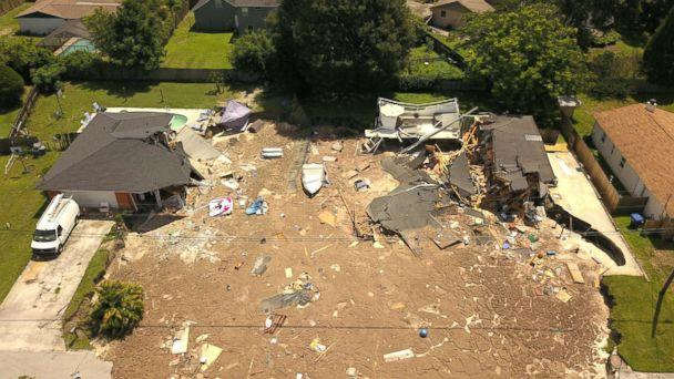 PHOTO: In this aerial photo, debris is strewn about after a sinkhole damaged two homes in Land O' Lakes, Fla., July 14, 2017. (Luis Santana/Tampa Bay Times via AP)