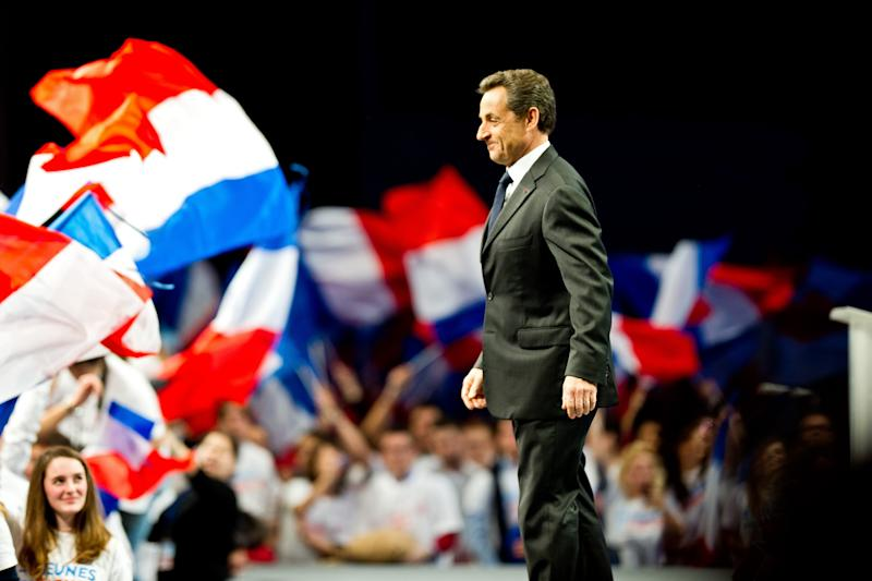 French President and candidate for the 2012 Presidential Elections Nicolas Sarkozy arrives at a meeting in Bordeaux, western France, Saturday, March 3, 2012. (AP Photo/Fred Lancelot)
