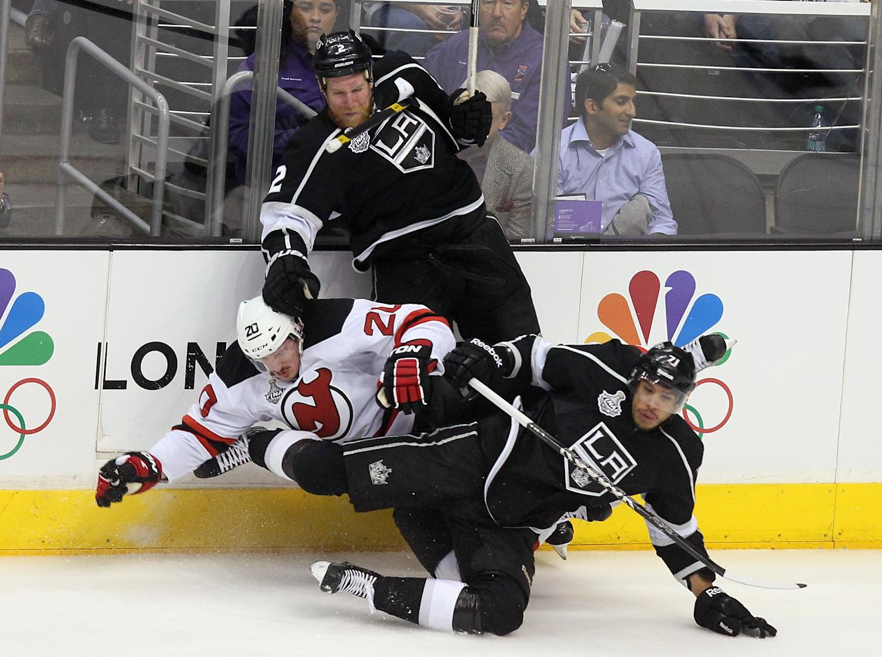 LOS ANGELES, CA - JUNE 11:  Matt Greene #2 and Jordan Nolan #71 of the Los Angeles Kings check Ryan Carter #20 of the New Jersey Devils in first period of Game Six of the 2012 Stanley Cup Final at Staples Center on June 11, 2012 in Los Angeles, California.  (Photo by Jeff Gross/Getty Images)
