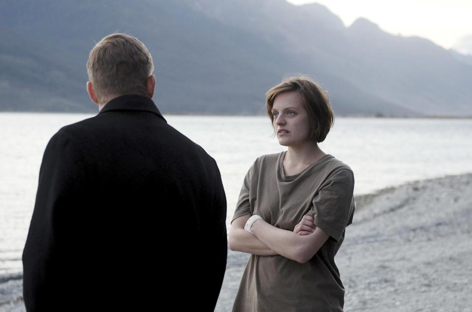 David Wenham and Elisabeth Moss stand by the water (Season 1)