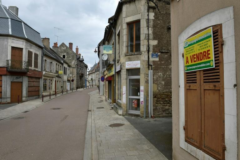 "With its deserted streets, ""For Sale"" signs and weeds pushing through the pavement, the village of Varzy symbolises the plight of the depressed French hinterland, a key theme in the presidential race"
