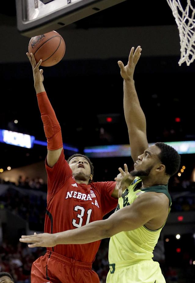 Nebraska's Shavon Shields (31) goes up for a shot as Baylor's Rico Gathers, right, defends during the first half of a second-round game in the NCAA college basketball tournament Friday, March 21, 2014, in San Antonio. (AP Photo/David J. Phillip)