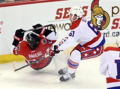 Washington Capitals' Steve Oleksy (61) checks Ottawa Senators' Jean-Gabriel Pageau (44) during the first period of their NHL hockey game in Ottawa, Ontario, Thursday, April 18, 2013. (AP Photo/The Canadian Press, Fred Chartrand)