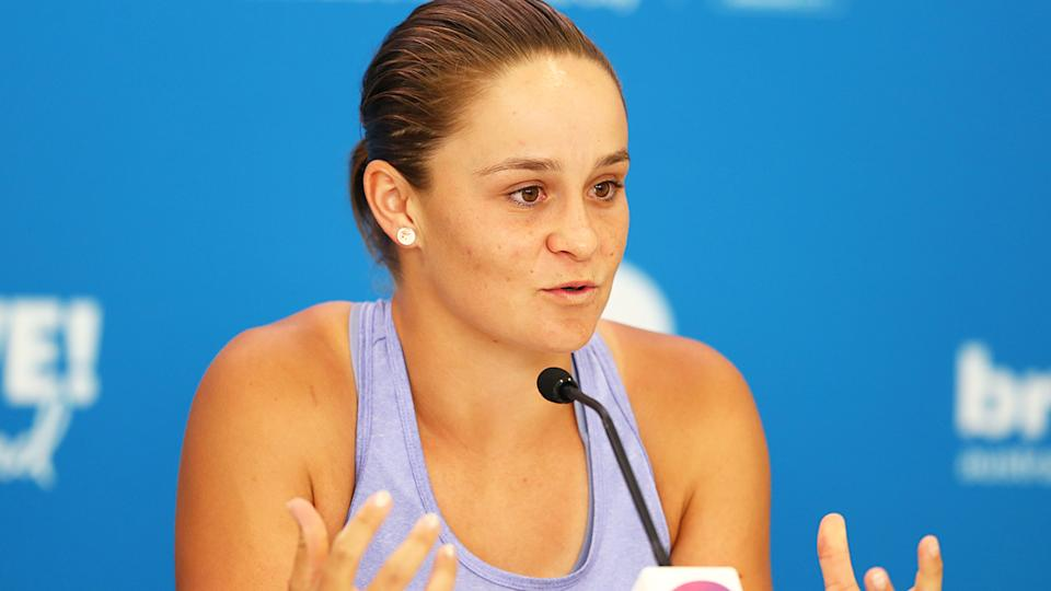 Ash Barty, pictured at a press conference for the Brisbane International, will donate her winnings to bushfire relief efforts.