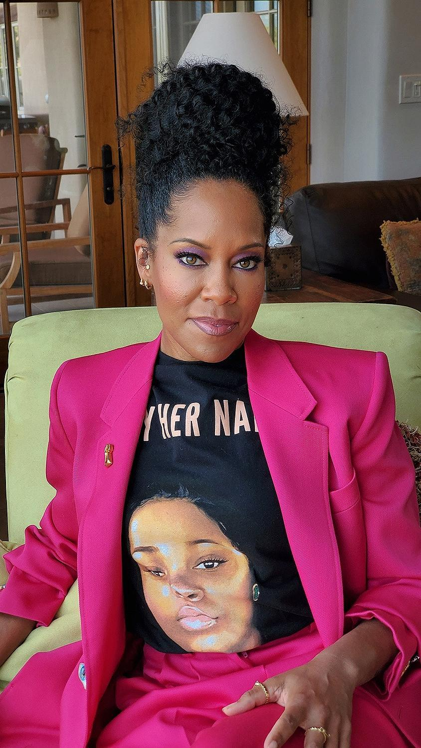 "<p>Instead of wearing a glamorous gown or comfortable pajamas to the virtual Emmys, <a href=""https://people.com/style/emmys-2020-regina-king-honors-breonna-taylor-statement-t-shirt/"" rel=""nofollow noopener"" target=""_blank"" data-ylk=""slk:King honored Breonna Taylor"" class=""link rapid-noclick-resp"">King honored Breonna Taylor</a>, the 26-year-old Black woman who was <a href=""https://people.com/crime/kentucky-emt-killed-by-police-family-seeks-answers/"" rel=""nofollow noopener"" target=""_blank"" data-ylk=""slk:fatally shot by police in a raid of her apartment"" class=""link rapid-noclick-resp"">fatally shot by police in a raid of her apartment</a> in an incident that sparked widespread protests, by wearing a <a href=""https://phenomenalwoman.us/collections/justice-for-breonna/products/breonna-taylor-t-shirt"" rel=""nofollow noopener"" target=""_blank"" data-ylk=""slk:Phenomenal Woman T-shirt"" class=""link rapid-noclick-resp"">Phenomenal Woman T-shirt</a> emblazoned with Taylor's face across the front. Across the top of the shirt read the phrase, ""SAY HER NAME,"" in all capital letters.</p> <p>King topped off the <a href=""https://phenomenalwoman.us/collections/justice-for-breonna/products/breonna-taylor-t-shirt"" rel=""nofollow noopener"" target=""_blank"" data-ylk=""slk:statement-making shirt"" class=""link rapid-noclick-resp"">statement-making shirt</a> (all profits benefit the <a href=""https://justiceforbreonna.org/"" rel=""nofollow noopener"" target=""_blank"" data-ylk=""slk:Breonna Taylor Foundation"" class=""link rapid-noclick-resp"">Breonna Taylor Foundation</a>) with a hot pink pantsuit by Schiaparelli.</p>"