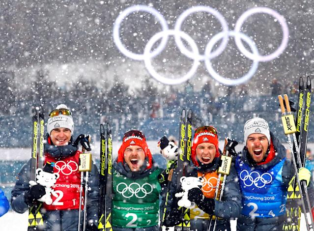 Nordic Combined Events - Pyeongchang 2018 Winter Olympics - Men's Team 4 x 5 km Final - Alpensia Cross-Country Skiing Centre - Pyeongchang, South Korea - February 22, 2018 - Gold medalists Vinzenz Geiger, Fabian Riessle, Eric Frenzel and Johannes Rydzek of Germany celebrate during the victory ceremony. REUTERS/Kai Pfaffenbach TPX IMAGES OF THE DAY