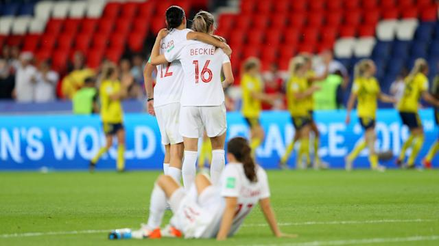 Christine Sinclair consoles Janine Beckie following their team's defeat in the 2019 FIFA Women's World Cup France Round Of 16 match between Sweden and Canada. (Photo by Richard Heathcote/Getty Images)