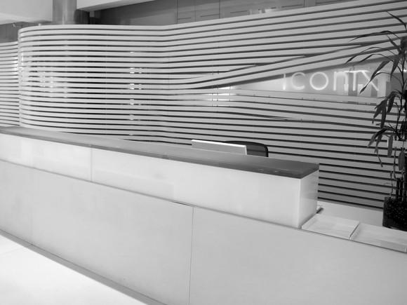 A lobby at Iconix headquarters. The office furniture, walls, and floor are all in glossy white.