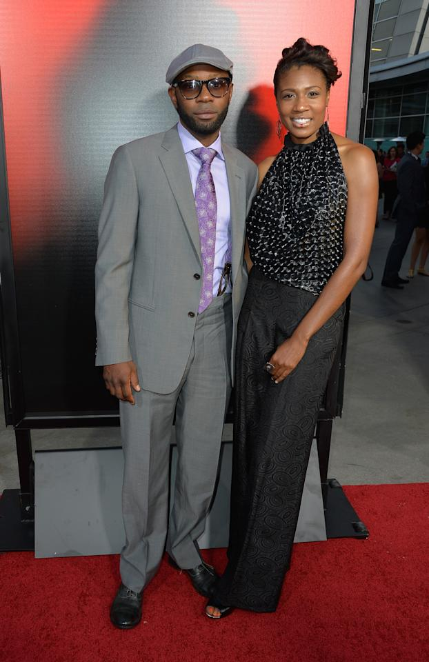 "HOLLYWOOD, CA - JUNE 11: Actor Nelsan Ellis and Guest attend the premiere of HBO's ""True Blood"" Season 6 at ArcLight Cinemas Cinerama Dome on June 11, 2013 in Hollywood, California. (Photo by Frazer Harrison/Getty Images)"
