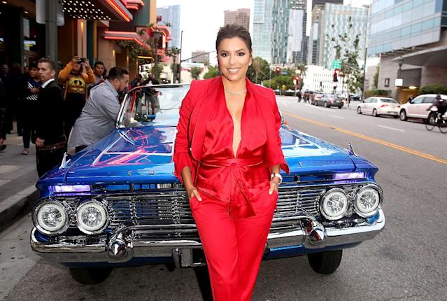<p>Longoria posed alongside a car that fit the theme of her new movie, <em>Lowriders</em>, at the film's L.A. premiere. (Photo: Jesse Grant/Getty Images) </p>