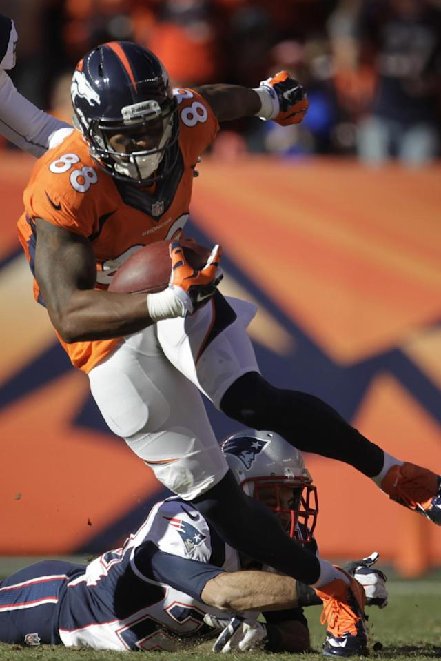 Denver Broncos wide receiver Demaryius Thomas (88) breaks a tackle from New England Patriots strong safety Steve Gregory (28) during the first half of the AFC Championship NFL playoff football game in Denver, Sunday, Jan. 19, 2014. (AP Photo/Joe Mahoney)