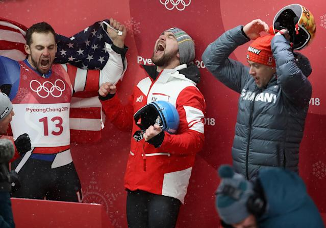 <p>Chris Mazdzer (silver) of the United States, David Gleirscher (gold) of Austria and Johannes Ludwig (bronze) of Germany celebrate following the Luge Men's Singles. </p>