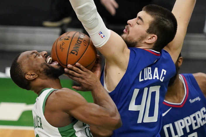Los Angeles Clippers center Ivica Zubac (40) blocks a shot attempt by Boston Celtics guard Kemba Walker in the fourth quarter of an NBA basketball game, Tuesday, March 2, 2021, in Boston. (AP Photo/Elise Amendola)