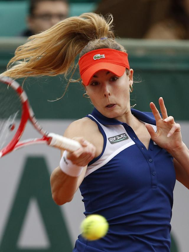 France's Alize Cornet returns the ball to Taylor Townsend, of the U.S, during the second round match of the French Open tennis tournament at the Roland Garros stadium, in Paris, France, Wednesday, May 28, 2014. (AP Photo/Darko Vojinovic)