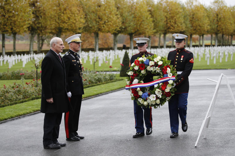 White House chief of staff John Kelly (left) and Chairman of the Joint Chiefs of Staff Marine Gen. Joseph Dunford attend a ceremony at the Aisne-Marne American Cemetery near the Belleau Wood battleground, in Belleau, France, on Saturday. (THE ASSOCIATED PRESS)