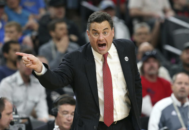 Arizona coach Sean Miller gestures during the first half of the team's NCAA college basketball game against UCLA in the semifinals of the Pac-12 men's tournament Friday, March 9, 2018, in Las Vegas. Arizona won 78-67 in overtime. (AP Photo/Isaac Brekken)