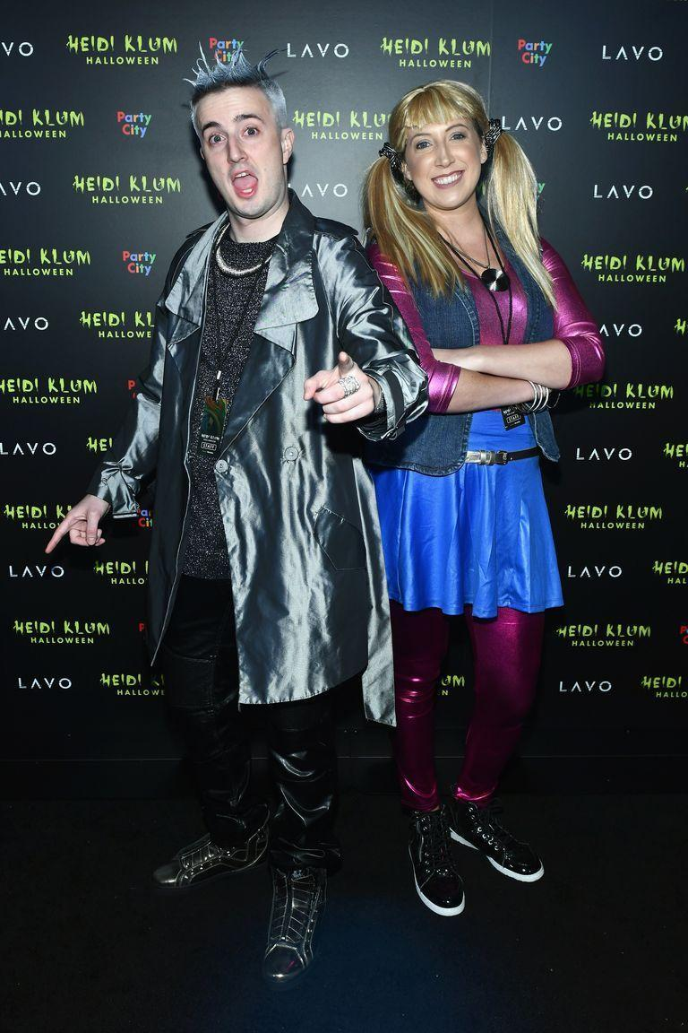 """<p>If you want to look totally supernova for Halloween, then take on intergalactic pair Zenon and Proto Zoa with lots of hair gel and shiny apparel.</p><p><a class=""""link rapid-noclick-resp"""" href=""""https://www.amazon.com/RAMISU-Womens-Fashion-Waterproof-Double-Breasted/dp/B08J9PSKFB?tag=syn-yahoo-20&ascsubtag=%5Bartid%7C10070.g.2683%5Bsrc%7Cyahoo-us"""" rel=""""nofollow noopener"""" target=""""_blank"""" data-ylk=""""slk:SHOP SILVER JACKET"""">SHOP SILVER JACKET</a></p><p><a class=""""link rapid-noclick-resp"""" href=""""https://www.amazon.com/Kepblom-Metallic-Turtleneck-Footless-Dancewear/dp/B07KVRDX5M?tag=syn-yahoo-20&ascsubtag=%5Bartid%7C10070.g.2683%5Bsrc%7Cyahoo-us"""" rel=""""nofollow noopener"""" target=""""_blank"""" data-ylk=""""slk:SHOP PINK BODYSUIT"""">SHOP PINK BODYSUIT</a></p>"""