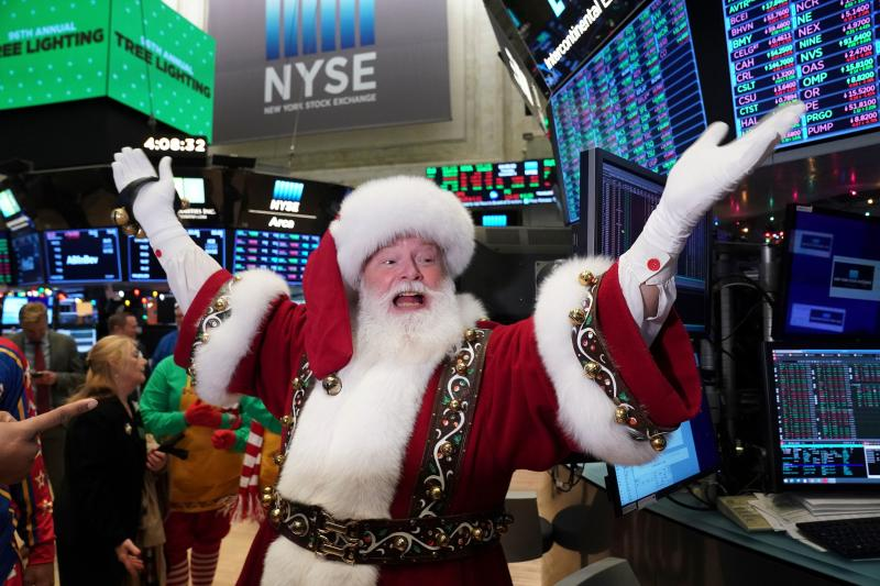 Santa Clause gestures on the floor at the closing bell of the Dow Industrial Average at the New York Stock Exchange on December 5, 2019 in New York. - Wall Street stocks finished slightly higher following a choppy session that avoided the big swings from earlier in the week on trade-oriented headlines. US and Chinese negotiators are working to finalize a preliminary trade deal announced in October that would block new tariffs expected to take effect this month. Officials have sent mixed signals on the talks, sending shares gyrating. (Photo by Bryan R. Smith / AFP) (Photo by BRYAN R. SMITH/AFP via Getty Images)