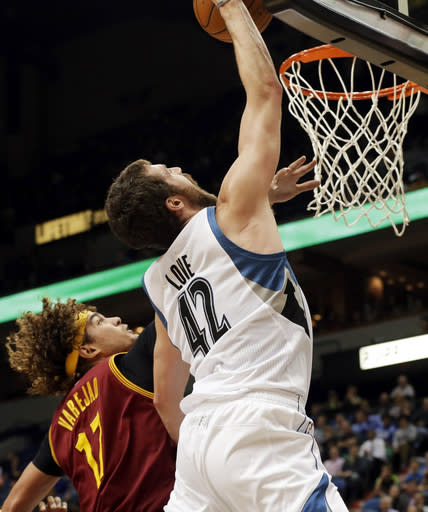 Minnesota Timberwolves' Kevin Love, right, jumps for a shot beyond the reach of Cleveland Cavaliers' Anderson Varejao, of Brazil, in the first quarter of an NBA basketball game Wednesday, Nov. 13, 2013, in Minneapolis. (AP Photo/Jim Mone)