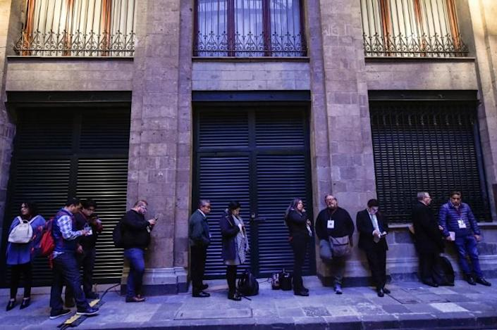 Journalists line up from 5:30 am outside the National Palace, on Mexico City's central square, to attend the president's daily press conference (AFP Photo/Pedro PARDO)