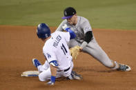 Colorado Rockies shortstop Trevor Story, right, tags out Los Angeles Dodgers' A.J. Pollock after Pollock attempts to stretch a single into a double during the fourth inning of a baseball game in Los Angeles, Sunday, Sept. 6, 2020. (AP Photo/Kelvin Kuo)