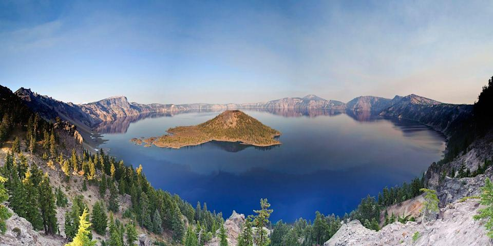 """<p>The centerpiece of <a href=""""https://www.tripadvisor.com/Attraction_Review-g143020-d144747-Reviews-Crater_Lake_National_Park-Crater_Lake_National_Park_Oregon.html"""" rel=""""nofollow noopener"""" target=""""_blank"""" data-ylk=""""slk:Crater Lake"""" class=""""link rapid-noclick-resp"""">Crater Lake</a>, a <a href=""""https://www.bestproducts.com/fun-things-to-do/g2543/best-national-parks-for-hiking/"""" rel=""""nofollow noopener"""" target=""""_blank"""" data-ylk=""""slk:national park"""" class=""""link rapid-noclick-resp"""">national park</a> in the Cascade Mountains of southern Oregon is, of course, the lake itself, a 6-mile-wide caldera created by the eruption and collapse of Mount Mazama thousands of years ago. The freshwater lake, surrounded by old-growth forest and 2,000-foot-high cliffs, is the deepest lake in America, and it's known for its deep blue color.</p>"""