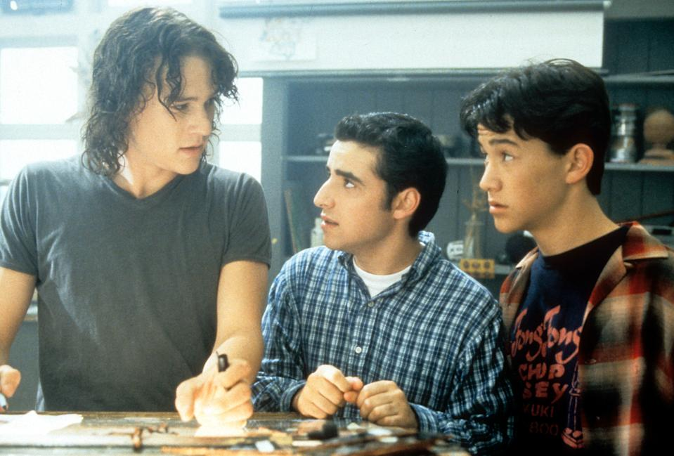 Heath Ledger, David Krumholtz, and Joseph Gordon-Levitt standing at table in a scene from the film '10 Things I Hate About You', 1999. (Photo by Buena Vista/Getty Images