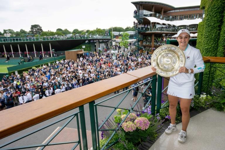 Show and tell: Australia's Ashleigh Barty poses with the winner's Venus Rosewater Dish trophy on the Members' Balcony