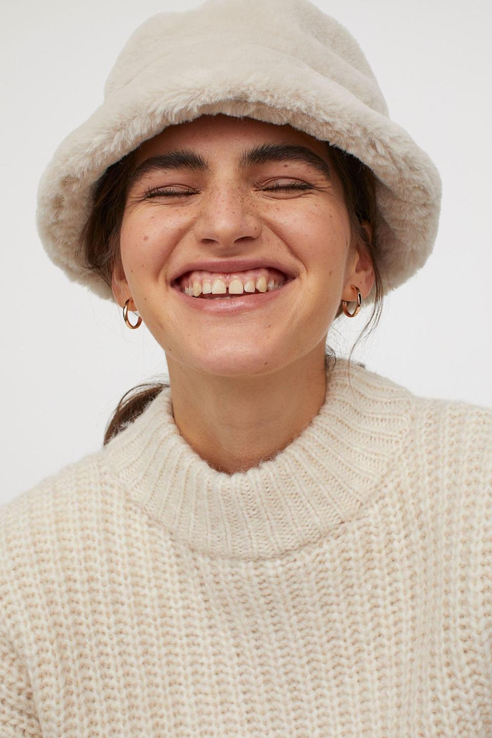 <p>The woven fabric of this <span>Bucket Hat</span> ($18) will keep your head warm against the winter chills.</p>