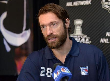 Jun 3, 2014; Los Angeles, CA, USA; New York Rangers center Dominic Moore (28) is interviewed during media day before game one of the 2014 Stanley Cup Final against the Los Angeles Kings at Staples Center. Mandatory Credit: Kirby Lee-USA TODAY Sports