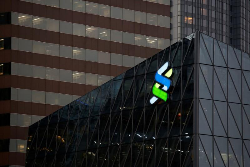 A logo of Standard Chartered is displayed at the financial Central district in Hong Kong