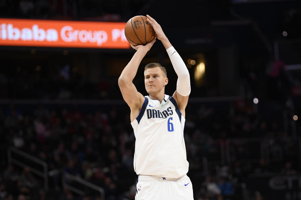 Dallas Mavericks forward Kristaps Porzingis (6) shoots during the first half of an NBA basketball game against the Washington Wizards, Friday, Feb. 7, 2020, in Washington. (AP Photo/Nick Wass)