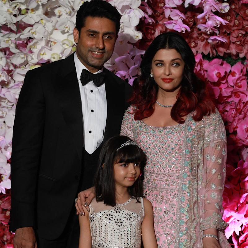 Bollywood actors Abhishek Bachchan and his wife Aishwarya Rai Bachchan, with their daughter Aaradhya - DIVYAKANT SOLANKI/EPA-EFE/Shutterstock