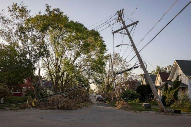 PHOTO: A downed power line leans over a street in Cedar Rapids, Iowa, Aug. 16, 2020. A rare Derecho storm battered large sections of Cedar Rapids leaving people homeless and without power.  (KC McGinnis/For The Washington Post via Getty Images)