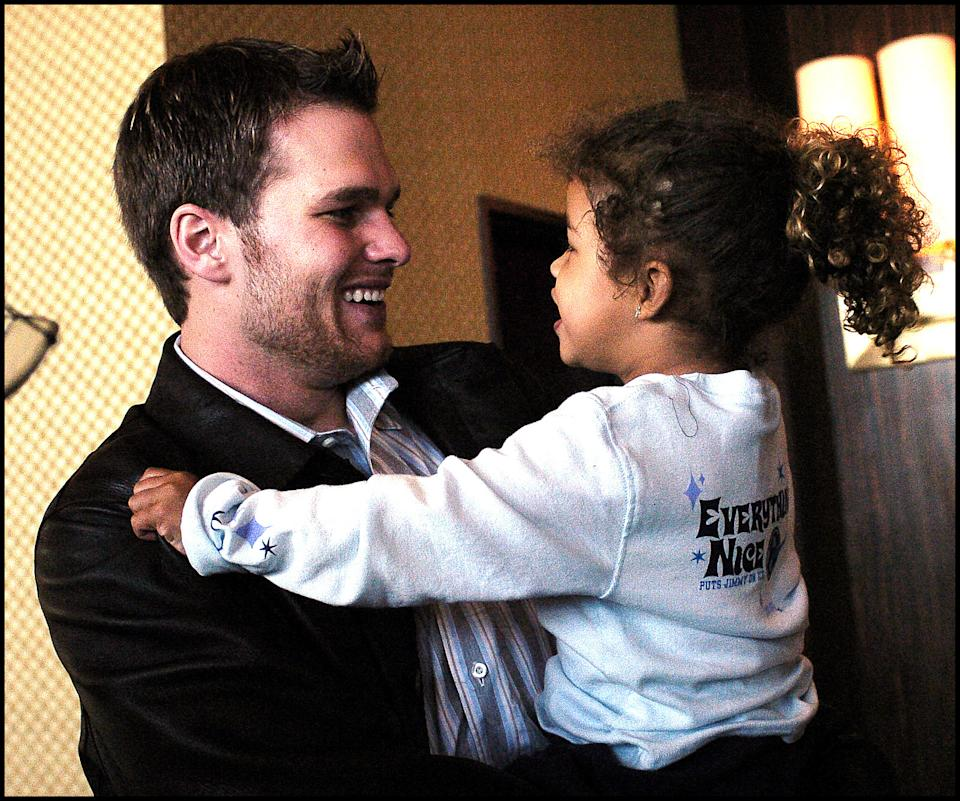 Tom Brady and a young Maya Brady.
