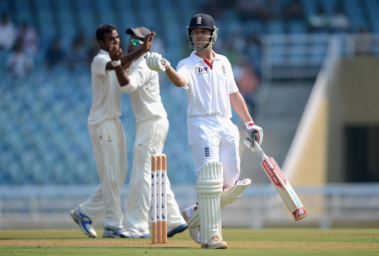 MUMBAI, INDIA - NOVEMBER 03:  Jonathan Trott of England leaves the field after being dismissed by Javed Khan of Mumbai A during day one of the tour match between Mumbai A and England at The Dr D.Y. Palit Sports Stadium on November 3, 2012 in Mumbai, India.  (Photo by Gareth Copley/Getty Images)