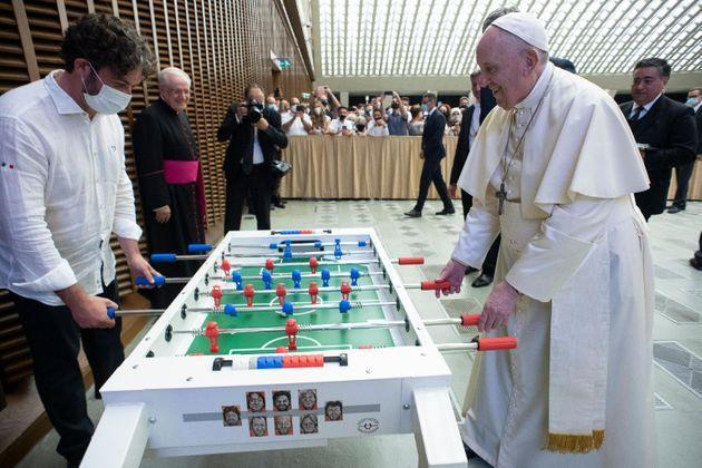 This handout photo provided by the Vatican Media shows Pope Francis playing soccer table during the weekly general audience in Paul VI Hall, Vatican City, 18 August 2021. ANSA/ VATICAN MEDIA (Photo: Vatican MediaANSA)