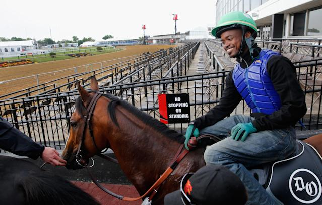 BALTIMORE, MD - MAY 15: Jockey Kevin Krigger takes Preakness entrant Goldencents out of the paddock in preparation for the 138th Preakness Stakes at Pimlico Race Course on May 15, 2013 in Baltimore, Maryland. (Photo by Rob Carr/Getty Images)