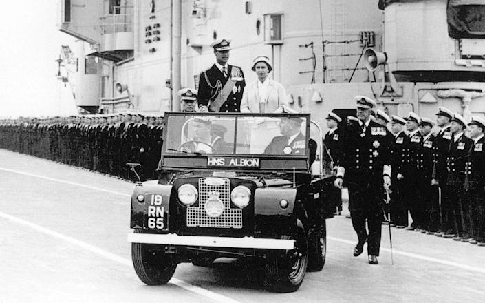 Queen Elizabeth II and Duke of Edinburgh in a special vehicle of Royal Land Rover in 1959.
