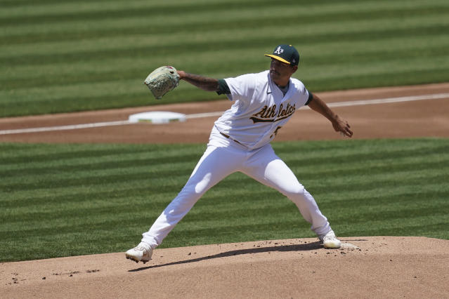 Oakland Athletics pitcher Sean Manaea throws against the Los Angeles Angels during the first inning of a baseball game in Oakland, Calif., Saturday, July 25, 2020. (AP Photo/Jeff Chiu)