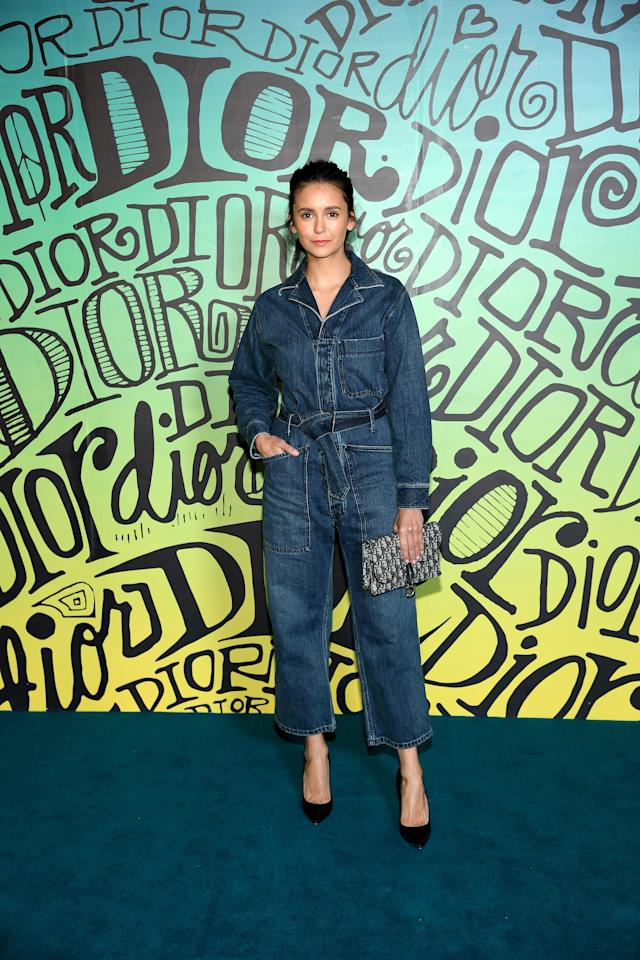 Nina Dobrev rocked this denim one-piece, and added a touch of extra style with black high heels.